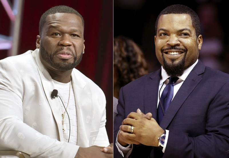 """Curtis """"50 Cent"""" Jackson participates in the Starz """"Power"""" panel at the Television Critics Association Summer Press Tour in Beverly Hills, Calif., on July 26, 2019, left, and BIG3 League founder Ice Cube at the debut of the BIG3 Basketball League in New York on June 25, 2017. An altered photo of the rappers in hats that appear to show support for President Donald Trump circulated widely on social media Tuesday, fueled in part by a tweet by Eric Trump. The manipulated image was shared thousands of times on Twitter and Facebook since it began gaining attention on Monday.  (AP Photo)"""