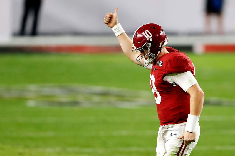 Mac Jones of the Alabama Crimson Tide gestures to the fans as he heads off the field during the fourth quarter of the College Football Playoff National Championship game against the Ohio State Buckeyes at Hard Rock Stadium on January 11, 2021 in Miami Gardens, Florida. (Photo by Sam Greenwood/Getty Images)