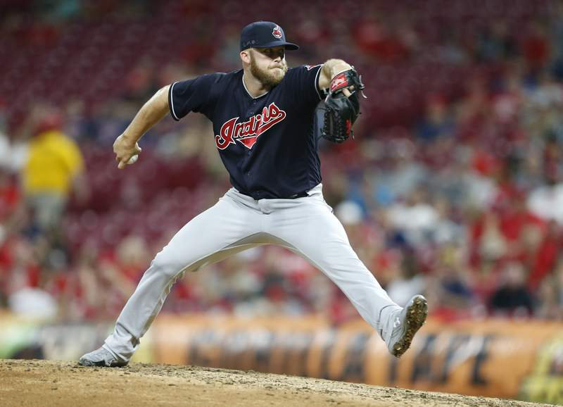 FILE - Cleveland Indians relief pitcher Cody Allen throws against the Cincinnati Reds during the eighth inning of a baseball game, in Cincinnati, in this Aug. 15, 2018, file photo. Cody Allen, the Cleveland Indians' career saves leader and an underappreciated closer for the team, has retired. The team announced Allen's retirement Wednesday, Feb. 17, 2021, on Twitter, posting: From a 23rd round draft pick to the franchise saves (leader). Congrats on a great career, Cody. (AP Photo/Gary Landers, File)