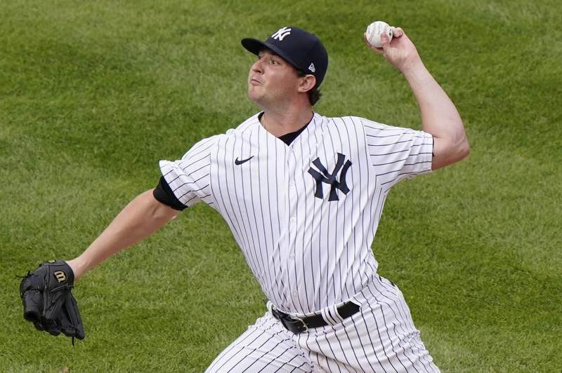 FILE - New York Yankees relief pitcher Zack Britton winds up during the eighth inning of a baseball game against the Baltimore Orioles in New York, in this Sunday, Sept. 13, 2020, file photo. Yankees left-hander Zack Britton is not throwing because of a sore pitching elbow, was to be examined by a doctor on Tuesday, March 9, 2021, and could miss the start of the season. (AP Photo/Kathy Willens, File)