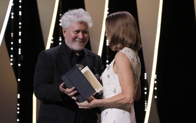 Pedro Almodovar, left, presents Jodi Foster with an honorary Palme d'Or at the opening ceremony of the 74th international film festival, Cannes, southern France, Tuesday, July 6, 2021. (Photo by Vianney Le Caer/Invision/AP)