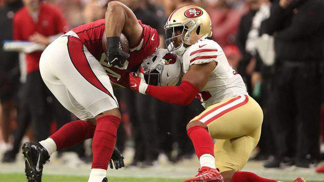 Linebacker Malcolm Smith of the San Francisco 49ers tackles tight end Jermaine Gresham of the Arizona Cardinals during a game in 2018. (Photo by Christian Petersen/Getty Images)