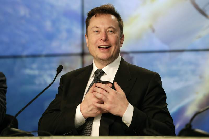 FILE - In this Sunday, Jan. 19, 2020. file photo, Elon Musk founder, CEO, and chief engineer/designer of SpaceX speaks during a news conference after a Falcon 9 SpaceX rocket test flight to demonstrate the capsule's emergency escape system at the Kennedy Space Center in Cape Canaveral, Fla. Elon Musk is not content with just electric cars, populating Mars and building underground tunnels to solve traffic problems. He also wants to get inside your brain. His startup, Neuralink, wants to one day implant computer chips inside people's brain.  (AP Photo/John Raoux, File)