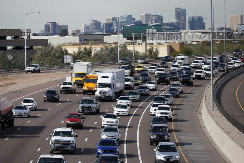 FILE - In this Jan. 24, 2020 file photo, early rush hour traffic rolls along I-10 in Phoenix. Traffic deaths in the U.S. fell for the third straight year in 2019, the government's road safety agency said Thursday, Oct. 1.  The National Highway Traffic Safety Administration says the downward trend is continuing into this year with people driving fewer miles due to the pandemic. (AP Photo/Ross D. Franklin, File)