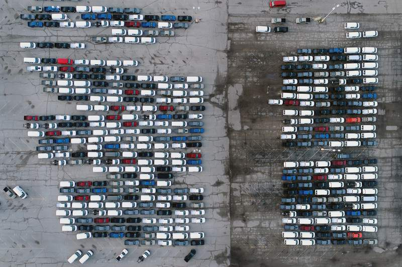 FILE - In this March 24, 2021 file photo, mid-sized pickup trucks and full-size vans are seen in a parking lot outside a General Motors assembly plant where they are produced in Wentzville, Mo. The global shortage of computer chips is getting worse, forcing automakers to temporarily close factories including those that build popular pickup trucks. General Motors announced Thursday, Sept, 2, 2021 that it would pause production at seven North American plants during the next two weeks, including two that make the companys top-selling Chevrolet Silverado pickup. (AP Photo/Jeff Roberson, File)