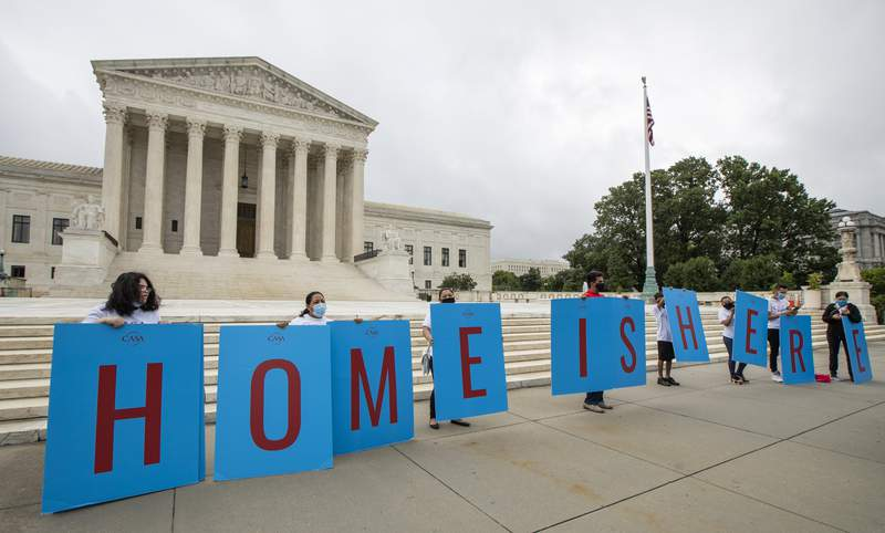 Deferred Action for Childhood Arrivals (DACA) students gather in front of the Supreme Court on Thursday, June 18, 2020, in Washington. The Supreme Court on Thursday rejected President Donald Trumps effort to end legal protections for 650,000 young immigrants, a stunning rebuke to the president in the midst of his reelection campaign. (AP Photo/Manuel Balce Ceneta)