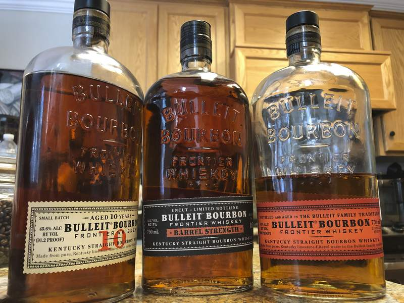 FILE - This Tuesday, Dec. 11, 2018, file photo shows bottles of Bulleit Bourbon, in Dublin, Calif. Spirits giant Diageo is going green with its newest whiskey-making venture in the Bluegrass State. Its distillery being built at Lebanon, Kentucky,  is expected to be carbon neutral  a first for the London-based company, it announced Monday, June 29, 2020. The $130 million distillery, which will produce Bulleit bourbon, is expected to be fully operational in 2021. (AP Photo/Ben Margot, FIle)
