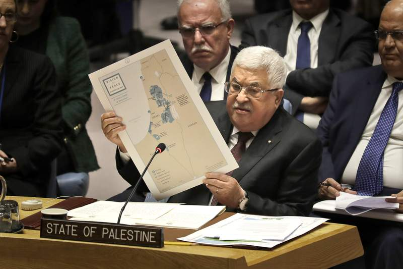 FILE - In this Feb. 11, 2020 file photo, Palestinian President Mahmoud Abbas speaks during a Security Council meeting at United Nations headquarters.  Abbas has announced that the first presidential and parliamentary elections since 2006 will be held later in 2021. The voting is seen as a key step in mending a rift between Abbas Fatah party that rules the West Bank and the Islamic militant group Hamas that controls the Gaza Strip. ( (AP Photo/Seth Wenig, File)