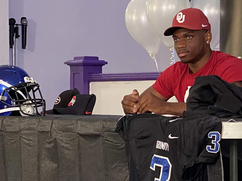 Trinity Christian running back Treyaun Webb relaxes after committing to Oklahoma on Saturday afternoon.