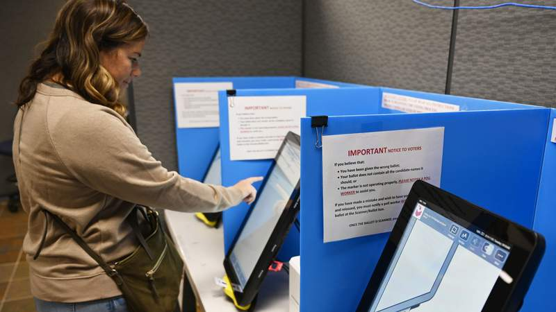 Courtney Parker votes on a new voting machine, in Dallas, Ga. New voting machines that combine touchscreens with paper ballots were purchased to retire the old system before any votes are cast in 2020.