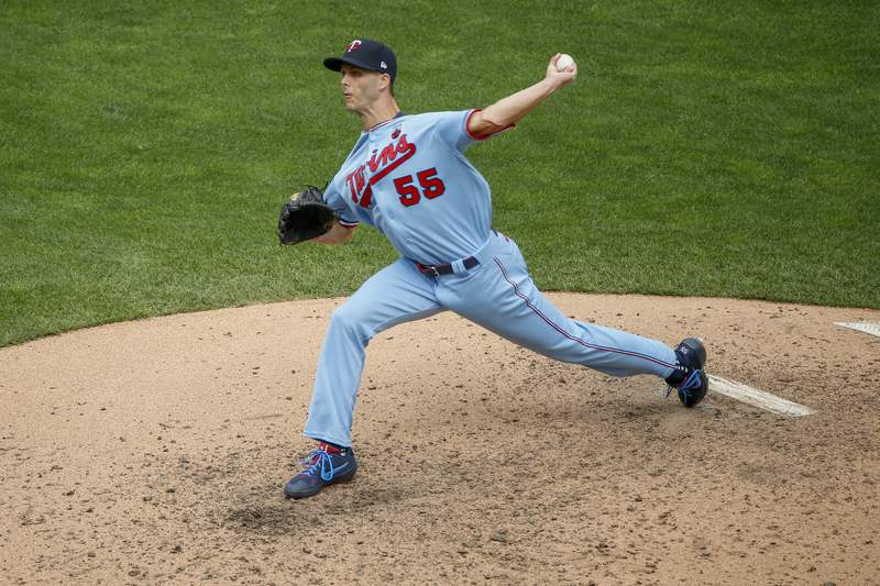 FILE - In this Aug. 16, 2020, file photo, Minnesota Twins pitcher Taylor Rogers throws to a Kansas City Royals batter during the eighth inning of a baseball game in Minneapolis. The Twins and closer Rogers have agreed to a $6 million, one-year contract, according to a person with knowledge of the deal. The person spoke to The Associated Press on condition of anonymity because the contract had not yet been finalized. (AP Photo/Bruce Kluckhohn)
