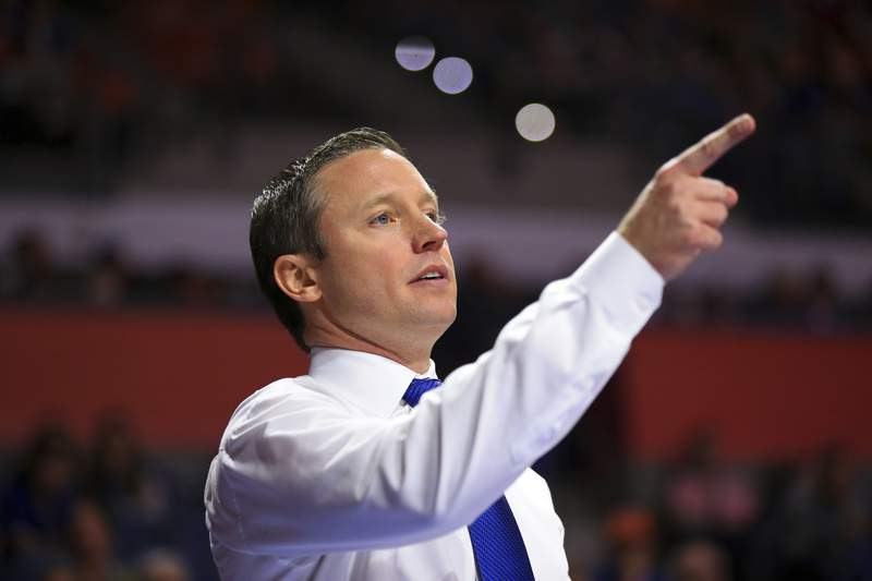 File-This Jan. 12, 2019, file photo shows Florida head coach Mike White directing his team  against Tennessee during an NCAA college basketball game Saturday, Jan. 12, 2019, in Gainesville, Fla. After winning a season-high four straight games, including road wins against Alabama and then-No. 13 LSU, the Gators (16-11, 8-6 Southeastern Conference) now face the last two teams in the Southeastern Conference standings. They are games Florida simply can't afford to lose. The two-game stretch begins Wednesday night at Vanderbilt (9-18, 0-14), where the Gators have dropped four in a row. No one on Florida's roster has experienced a victory at Memorial Gym in Nashville, Tennessee. White has dealt with even more futility there. He's 0-9 at Vanderbilt, including 0-2 as a player at Mississippi (1995-99), 0-4 as an assistant coach with the Rebels (2004-11) and winless in three trips as Florida's head coach. (AP Photo/Matt Stamey, File)