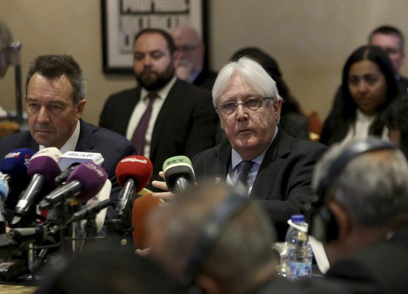 FILE - In this Feb. 5, 2019 file photo, United Nations Special Envoy to Yemen Martin Griffiths, center, and President of the International Committee of the Red Cross Peter Maurer, speak during a new round of talks by Yemen's warring parties in Amman, Jordan.  Yemens warring sides on Friday, Sept. 18, 2020,  started U.N.-brokered peace consultations in Switzerland to exchange prisoners, the United Nations said, part of a long-delayed deal aiming to end a conflict that has killed thousands of civilians and set off the worlds worst humanitarian crisis. (AP Photo/Raad Adayleh)