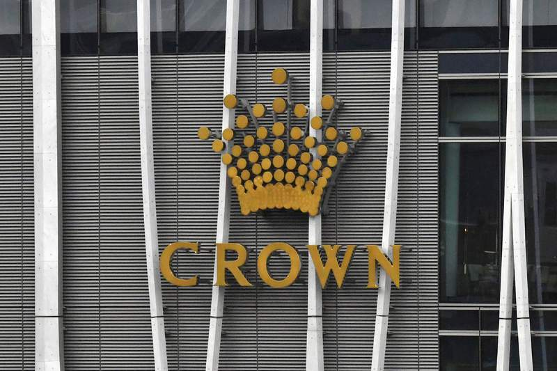 The Crown logo is seen on Crown Sydney Tower at Barangaroo in Sydney on Dec. 28, 2020. An inquiry has found Australian gambling company Crown Resorts unfit to run its new Sydney casino because it facilitated money laundering and had other problems. Commissioner Patricia Bergin recommended several changes Crown should make before it could run the casino. (Mick Tsikas/AAP Image via AP)