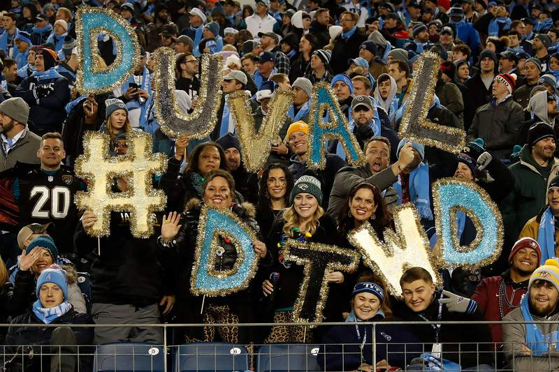 NASHVILLE, TN - DECEMBER 06:  Fans of the Jacksonville Jaguars hold up letters spelling Duval #DTWD during a game against the Tennessee Titans at Nissan Stadium on December 6, 2018 in Nashville, Tennessee.  (Photo by Frederick Breedon/Getty Images)