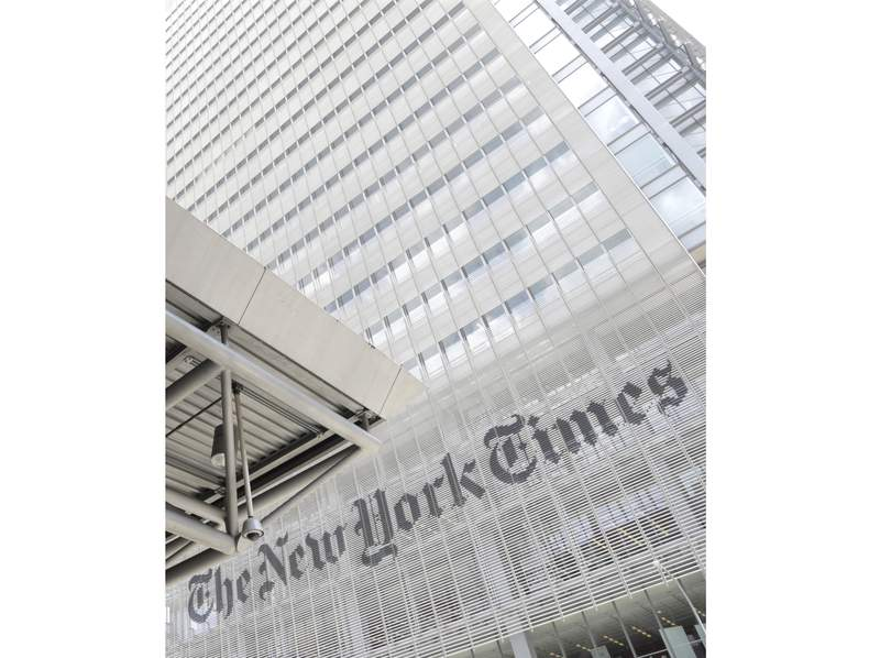 FILE - This June 22, 2019 file photo shows the exterior of the New York Times building in New York. Media companies are balancing the need to cover the coronavirus outbreak with the need to keep their employees safe. The New York Times told its employees this week that if they want to work remotely they can do so. For most people, the new coronavirus causes only mild or moderate symptoms, such as fever and cough. For some, especially older adults and people with existing health problems, it can cause more severe illness, including pneumonia. The vast majority of people recover from the new virus. According to the World Health Organization, people with mild illness recover in about two weeks, while those with more severe illness may take three to six weeks to recover. (AP Photo/Julio Cortez, File)