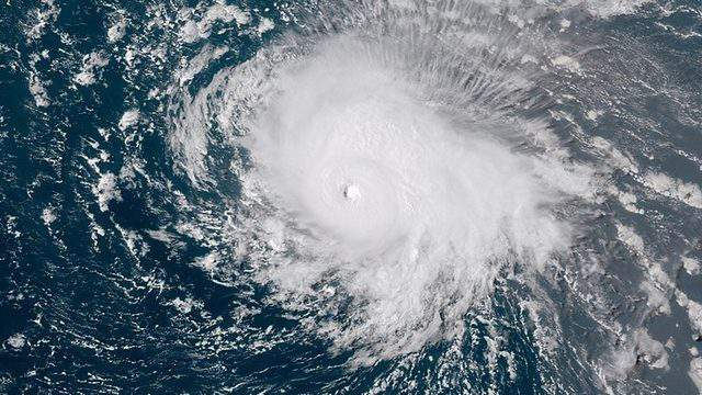Hurricane Florence aiming at the U.S. East Coast at peak Category 4 intensity south of Bermuda before weakening to a Cat. 1 at landfall.