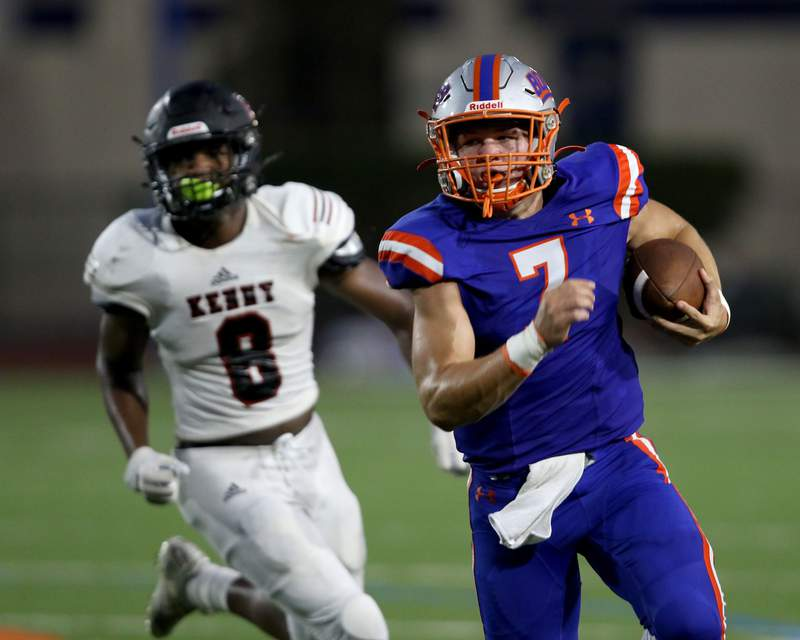 Bolles QB Gunner Boree (7) eludes Bishop Kenny LB Miles Cameron (8) during a scrimmage at Skinner-Barco Stadium in Jacksonville, FL, Friday September 4, 2020.