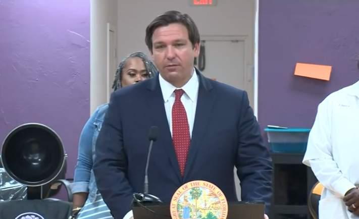 Gov. Ron DeSantis holds a COVID-19 meeting at a hair salon in Orlando.