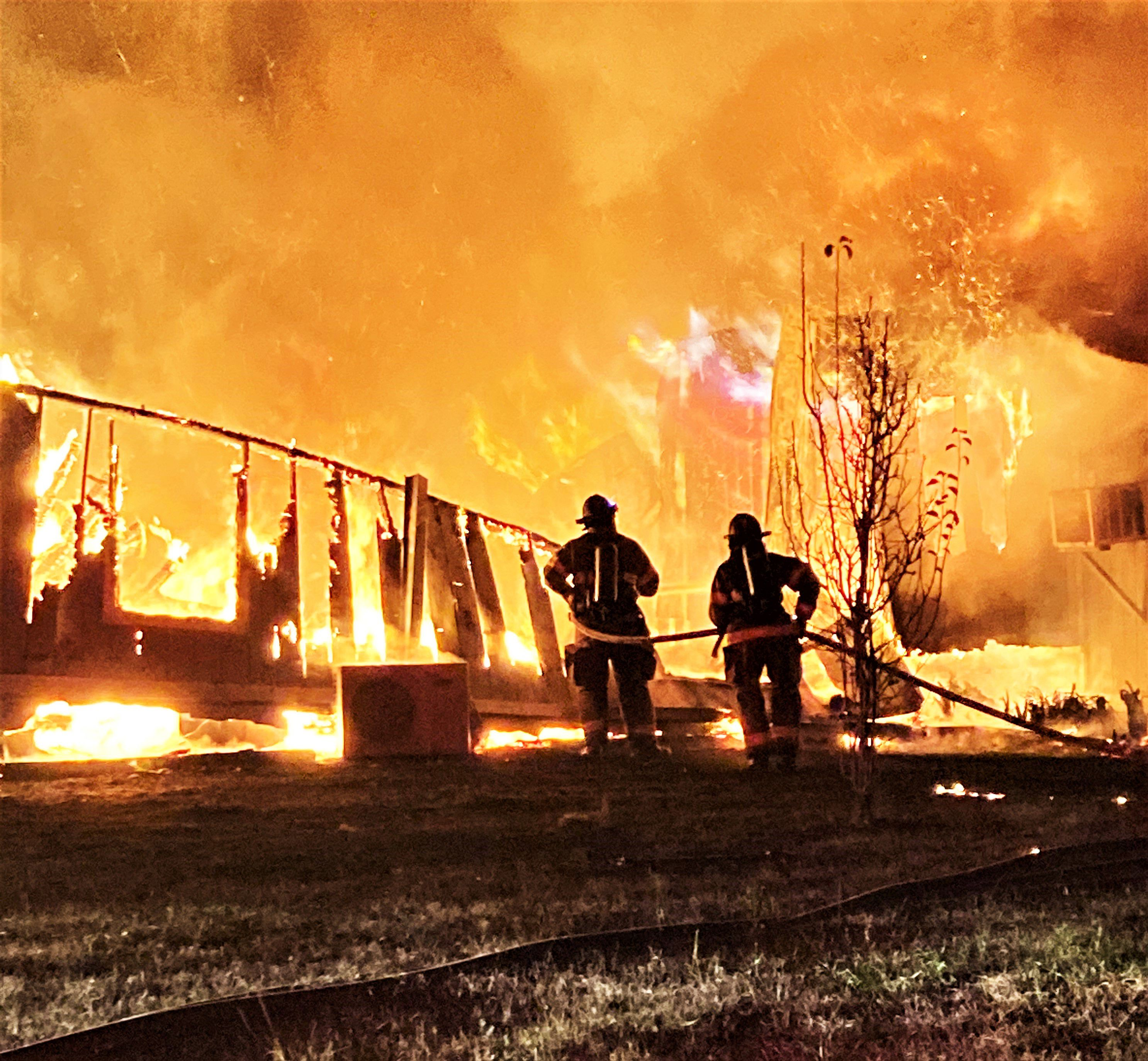 Photos show firefighters battle intense house fire in Bradford County