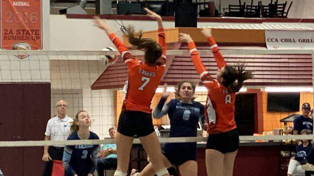 Christ's Church volleyball players Julia Mangum (7) and Virginia Hudson (8) block a shot during a Region 1-2A final against Seven Rivers Christian on Tuesday night.