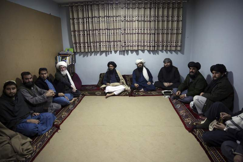 FILE - In this Dec. 14, 2019 file photo, jailed Taliban sit inside the Pul-e-Charkhi Jail after speaking with The Associated Press, in Kabul, Afghanistan. A three-member Taliban technical team arrived Tuesday, March 31, 2020, in the Afghan capital to oversee the release of their prisoners as part of a peace deal signed by the Taliban and the U.S., a spokesman for the insurgent group said. (AP Photo/Rahmat Gul, File)