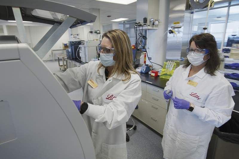 FILE - In this May 2020 photo provided by Eli Lilly, researchers prepare cells to produce possible COVID-19 antibodies for testing in a laboratory in Indianapolis. (David Morrison/Eli Lilly via AP, File)