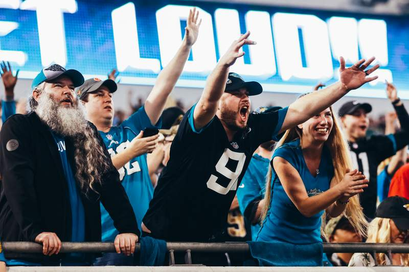 Excited fans of the Jacksonville Jaguars after the team quickly scores back-to-back touchdowns against the Indianapolis Colts in the fourth quarter at TIAA Bank Field on December 29, 2019 in Jacksonville, Florida. (Photo by Harry Aaron/Getty Images)