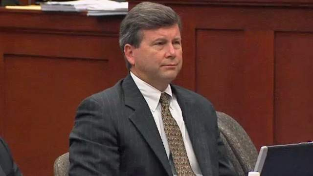 Kelly Mathis sits in the courtroom during his trial.