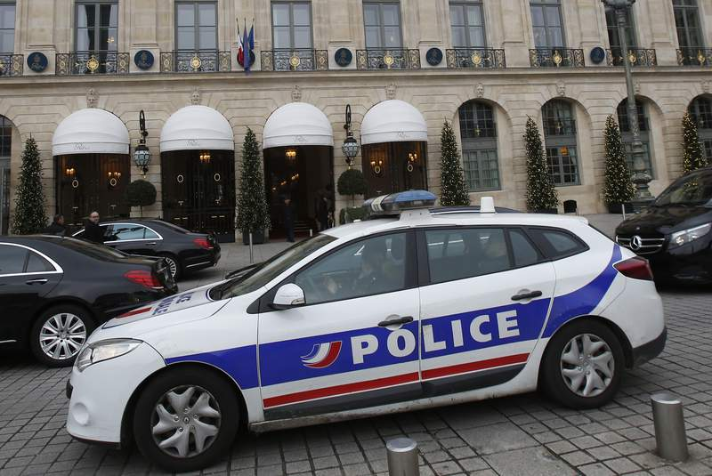 FILE - In this April 15, 2020 file photo a police car drives past the Ritz hotel in Paris. One of France's biggest unsolved criminal cases appears to have been cracked. Prosecutors announced that DNA from a 59-year-old former gendarme who killed himself this week corresponded to genetic traces found at the scene of the crimes. The horrors began with the rape and strangling of an 8-year-old girl named Sarah in 1986 that was never solved. (AP Photo/Michel Euler, File)
