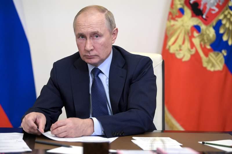 Russian President Vladimir Putin leads a cabinet meeting via video conference at the Novo-Ogaryovo residence outside Moscow, Russia, Tuesday, Oct. 5, 2021. (Alexei Druzhinin, Sputnik, Kremlin Pool Photo via AP)