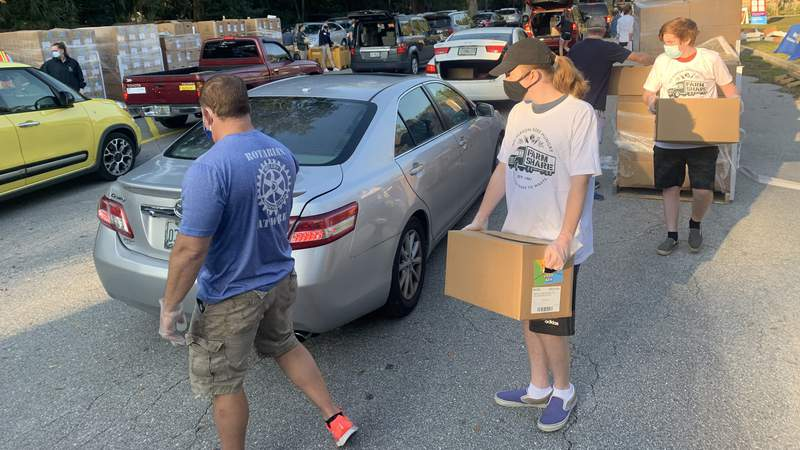 Hundreds of cars visited the drive-thru food distribution on Timuquana Road.
