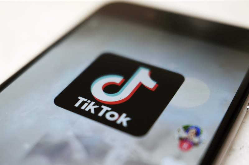 FILE - This Monday, Sept. 28, 2020, file photo, shows as  logo of a smartphone app TikTok on a user post on a smartphone screen in Tokyo. Canadian e-commerce platform Shopify said Tuesday, Oct. 27, 2020, its made a deal with TikTok enabling merchants to create shoppable video ads that drive customers to online stores. (AP Photo/Kiichiro Sato, File)