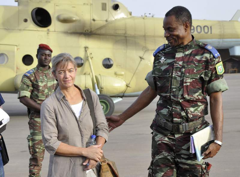 FILE - In this April 24, 2012, file photo, released Swiss hostage Beatrice Stoeckli, left, stands in Ouagadougou, Burkina Faso, following arrival by helicopter from Timbuktu, Mali, after being handed over by militant Islamic group Ansar Dine. Switzerlands Foreign Ministry said Friday, Oct. 8, 2020, that Stoeckli has been killed by an Islamist group. The ministry said it was informed by French authorities that the hostage had been killed by kidnappers of the Islamist terrorist organization Jamaat Nusrat al-Islam Muslimeen about a month ago. Stoeckli was kidnapped four years ago. (AP Photo/Brahima Ouedraogo, File)