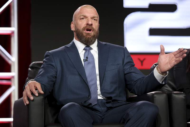 """FILE - In this Jan. 9, 2018, file photo, Paul """"Triple H"""" Levesque participates in the """"WWE Monday Night Raw: 25th Anniversary"""" panel during the NBCUniversal Television Critics Association Winter Press Tour in Pasadena, Calif. With most American sports already settled in to their old routines, WWE is set to ditch its stopgap home in Florida and resume touring starting Friday night with """"Smackdown"""" from Houston, a pay-per-view Sunday in Texas and a return Monday to Dallas for the flagship """"Raw"""" taping. (Photo by Willy Sanjuan/Invision/AP)"""