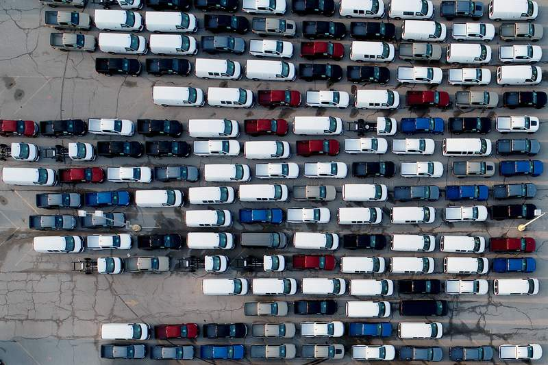 FILE - In this aerial photo, mid-sized pickup trucks and full-size vans are seen in a parking lot outside a General Motors assembly plant where they are produced Wednesday, March 24, 2021, in Wentzville, Mo. (AP Photo/Jeff Roberson)