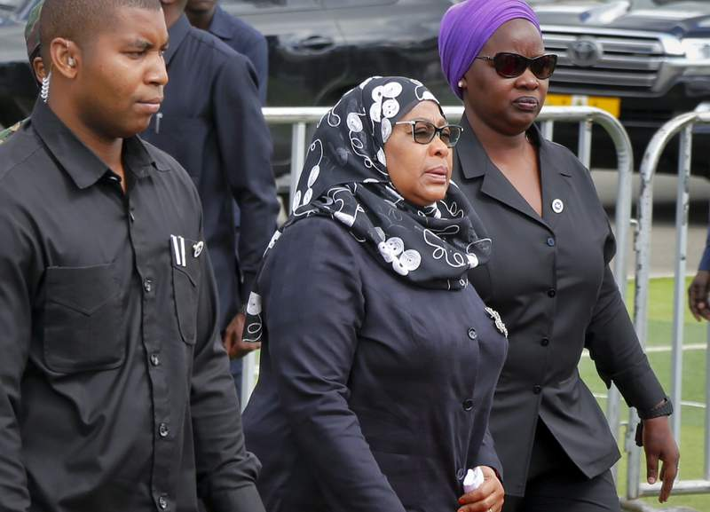 FILE - In this March 20, 2021 record  photo, Tanzania's caller   President Samia Suluhu Hassan, center, arrives to wage  her respects arsenic  the assemblage  of erstwhile  president   John Magufuli lies successful  authorities   astatine  Uhuru stadium successful  Dar es Salaam, Tanzania. Tanzania has received its archetypal  batch of 1 cardinal  Johnson & Johnson COVID-19 vaccines donated by the U.S. Tanzania had been among the fewer  countries successful  Africa yet to person   vaccines oregon  commencement  vaccinating its population, chiefly  due to the fact that its erstwhile  person  had claimed supplication  had defeated COVID-19 successful  the country. (AP Photo, File)