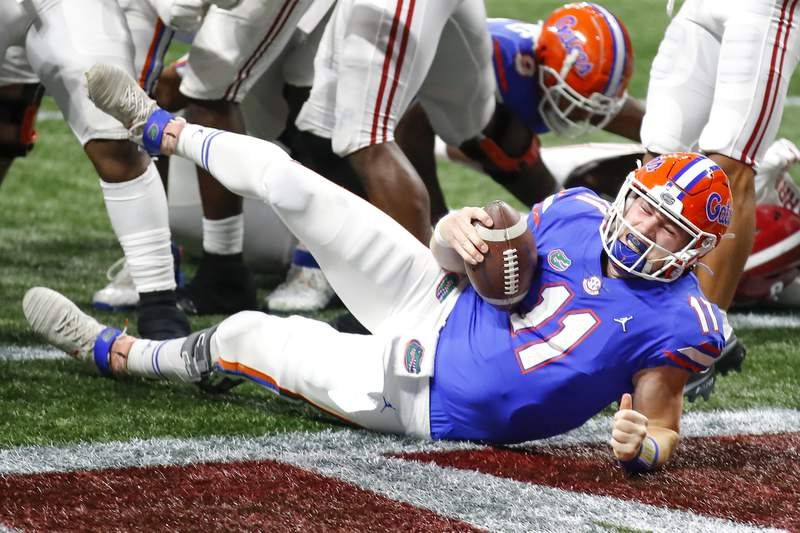 ATLANTA, GA - DECEMBER 19: Quarterback Kyle Trask #11 of the Florida Gators rushes in for a touchdown in the first half against the Alabama Crimson Tide during the SEC Championship game at Mercedes-Benz Stadium on December 19, 2020 in Atlanta, Georgia. (Photo by Todd Kirkland/Getty Images)