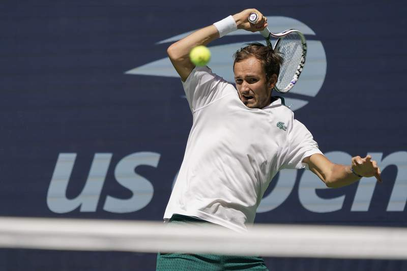 Daniil Medvedev, of Russia, returns a shot to Botic Van de Zandschulp, of the Netherlands, during the quarterfinals of the US Open tennis championships, Tuesday, Sept. 7, 2021, in New York. (AP Photo/Elise Amendola)