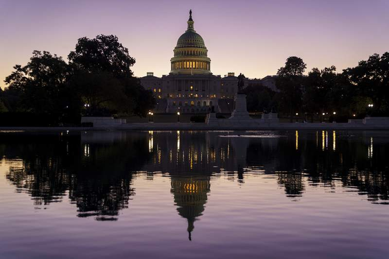 FILE - In this Sept. 27, 2021, file photo the Capitol is seen at dawn in Washington. (AP Photo/J. Scott Applewhite, File)