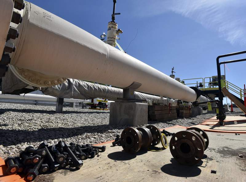FILE - In this June 8, 2017, file photo, fresh nuts, bolts and fittings are ready to be added to the east leg of the Enbridge Line 5 pipeline near St. Ignace, Mich., as Enbridge prepares to test the east and west sides of the Line 5 pipeline under the Straits of Mackinac in Mackinaw City, Mich. The Michigan Court of Appeals ruled Thursday, June 11, 2020, that legislators did not violate the state constitution by allowing construction of an oil pipeline tunnel beneath a channel linking two of the Great Lakes. A three-judge panel affirmed a ruling last November by the Michigan Court of Claims, which upheld a law authorizing a deal between former Republican Gov. Rick Snyder and Canadian pipeline company Enbridge. (Dale G. Young/Detroit News via AP, File)