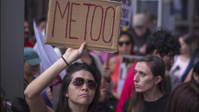 Demonstrators participate in the #MeToo Survivors' March in response to several high-profile sexual harassment scandals on November 12, 2017 in Los Angeles, California.