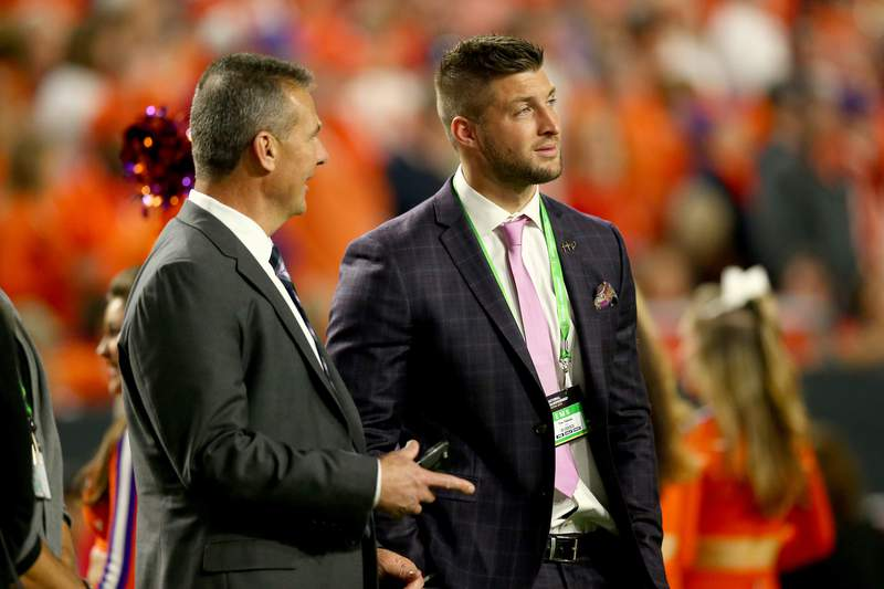FILE: Urban Meyer talks with Tim Tebow during the 2016 College Football Playoff National Championship Game at University of Phoenix Stadium on January 11, 2016, in Glendale, Arizona. (Photo by Ronald Martinez/Getty Images)