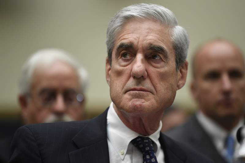 FILE - In this July 24, 2019, file photo former special counsel Robert Mueller testifies on Capitol Hill in Washington before the House Judiciary Committee hearing on his report on Russian election interference. Mueller pushed back Tuesday, Sept. 29, 2020, against criticism from one of the top prosecutors on the Russia investigation team that the team was not as aggressive as it should have been in probing connections between Donald Trump's 2016 campaign and Russia. (AP Photo/Susan Walsh, File)