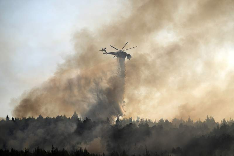 Crews race contain fire near Athens after thousands flee
