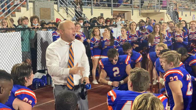 Bolles coach Matt Toblin talks to players after the Bulldogs beat Gadsden County 10-7 in the Class 4A state semifinals on Friday night.