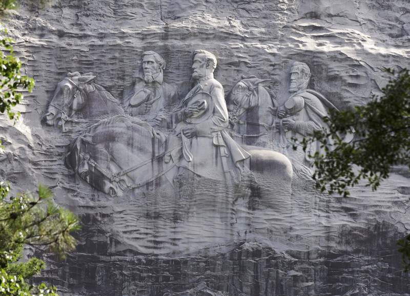 File photo shows a carving depicting Confederate Civil War figures Stonewall Jackson, Robert E. Lee and Jefferson Davis, in Stone Mountain, Ga. The sculpture is America's largest Confederate memorial.