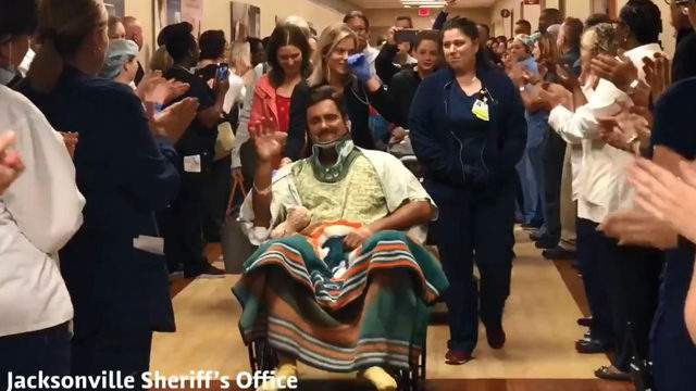 Officer Jack Adams cheered by Memorial Hospital staff, fellow officers as he's transferred to rehab after DUI crash that killed his wife, a Jacksonville Sheriff's Office bailiff.