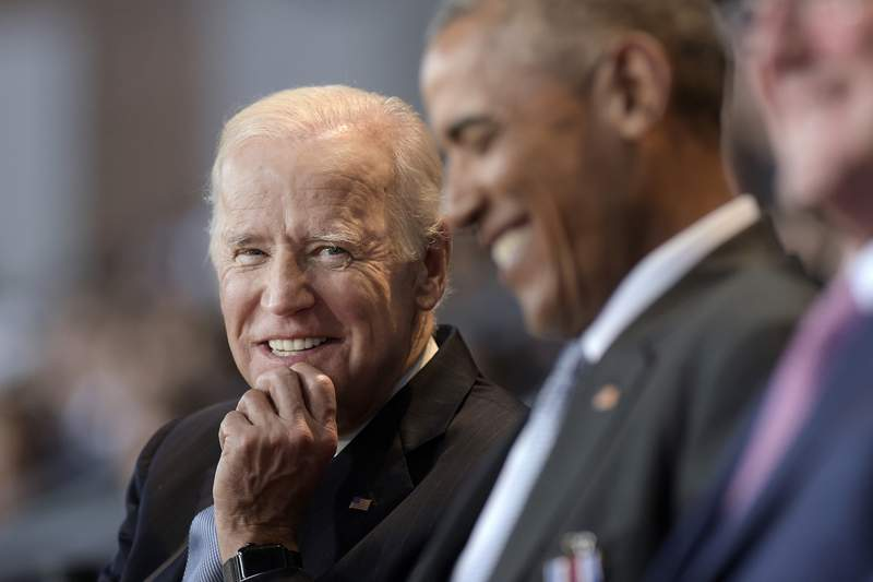 FILE - In this Jan. 4, 2017 file photo, Vice President Joe Biden, left, watches President Barack Obama, center, at Conmy Hall, Joint Base Myer-Henderson Hall, Va. Democrats hoping to create a surge of enthusiasm behind Joe Bidens presidential bid will look to Wednesdays convention headliners to broaden the party's focus from a rebuke of President Donald Trump to a message of change. Former President Barack Obama has top billing for the third night of the all-virtual Democratic National Convention. (AP Photo/Susan Walsh)