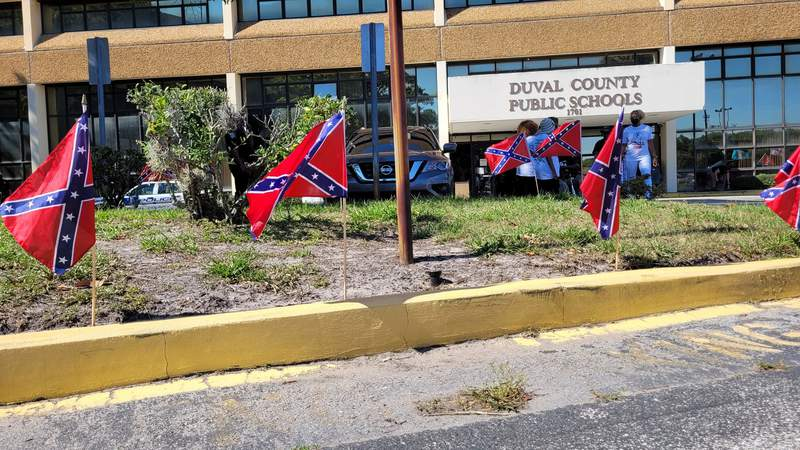 Opponents to the school name changes posted about a dozen confederate flags on Duval Schools property during a demonstration.